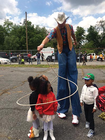 A stiltwalker was among the attractions at the 100th annual Mothers Day Parade in Chester.