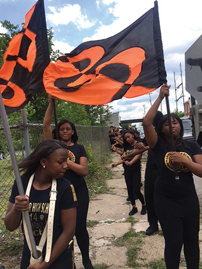 Chester High School students carried the black and orange flags as they marched.