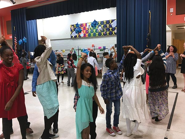 Give your girl a twirl. Students at Park Lane Elementary School perform the dances they learned during Dancing Classrooms Philly.
