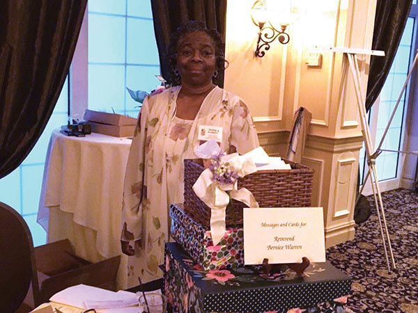 Tonya Warren, Chester Eastside's director of Operations and Community Programs, stood near a basket for cards and messages for Rev. Warren.