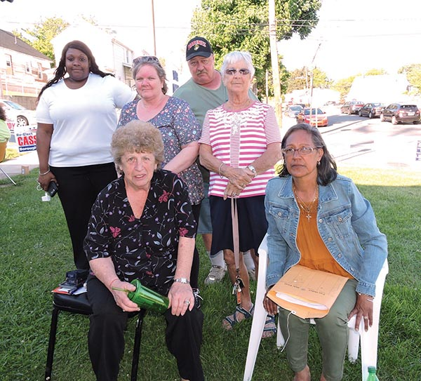 Trainer Republican candidates for Council greeted voters outside the borough community center on Tuesday. Pictured are, seated: incumbent Council President Regina Beck and incumbent Councilwoman Awilda Burgos. Standing are  challengers Jennifer Frazier, Marcia Kline and Ralph Miles, and incumbent Mayor Frances Zalewski.