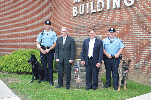 Standing with (from left) new police canine Hannes, is Ridley Township police officer Matt Rowan, District Attorney Jack Whelan, Delaware County Councilman Dave White, Ridley police officer Brian Judge and his new canine partner Zork. Prior to their joining the force, Ridley Township police hadn't had K9's for over 20 years. Both dogs have received patrol and narcotics training.