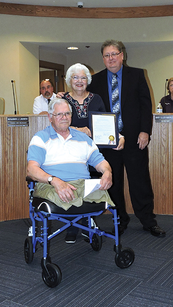 Retired Brookhaven clerk Mary Jo Ruth poses with her husband, John, and Council President John Wilwert, Jr. after being presented a plaque from the borough.