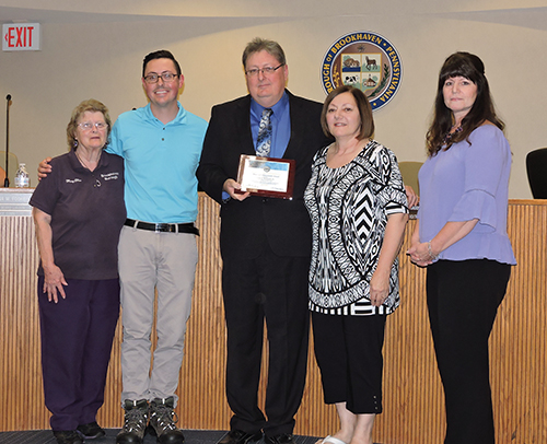 Brookhaven Council President John Wilwert, Jr. was presented a plaque from the Pennsylvania Association of Boroughs for his dedication to the borough. Pictured with Wilwert is borough secretary Mary McKinley, his son, Tim, wife, Lori, and Councilwoman Denise Leslie.