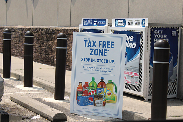 A sign at the Glenolden Rite Aid beckons customers with an in-your-face reminder that Delaware County has no additional tax on soft drinks.
