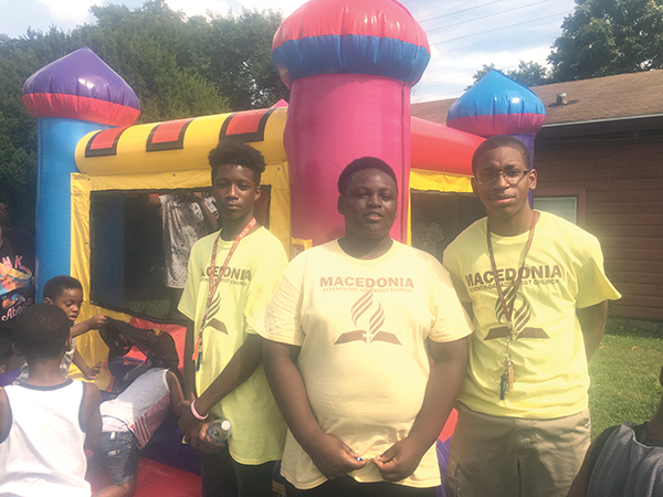 Dion Allen, Anthony Washington and Latif McIver stand guard at the bounce house.