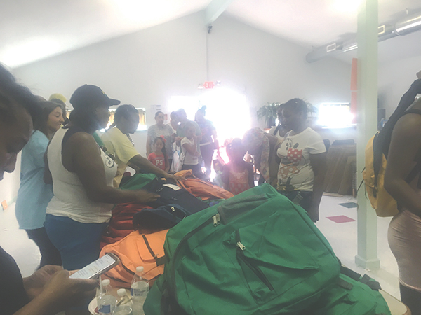 Book bags and school uniforms were given away to dozens of families at the event.