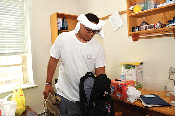 Freshman King David Bey removed items from his backpack.