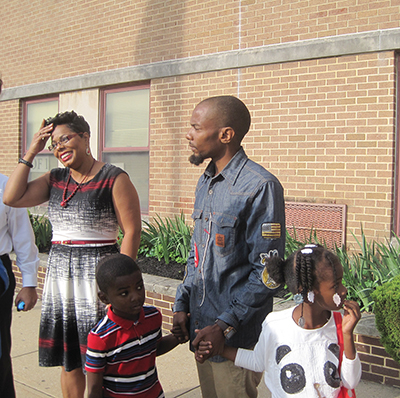 Stonehurst Hills Elementary School Principal Aaronda Beauford greets all children and families on the first day of school participating in the Million Father March. Standing with Beauford are (from left) Antonio Jones, 4, entering Kindergarten; his dad, Anthony Jones, and daughter,Amore, 6, a first grader.