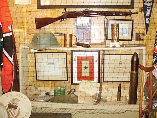 At the Darby VFW Post 598, there are walls of artifacts representing various wars. The WWI Wall features weapons and assorted memorabilia.