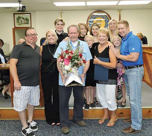 Cliff and Carol Thompson pose with their family after being recognized on the event of their 50th wedding anniversary by the Aston Board of Commissioners.