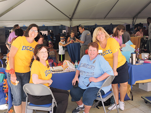 DCCC employees Pauline Marino, Debbie Cascarino, Rita Godfrey and Tricia Sceparsky manned a table during the 50th anniversary celebration.