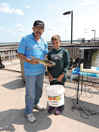 Marcus Hook councilman and fishing derby organizer Joe Flynn with participant Bubba Hughes.
