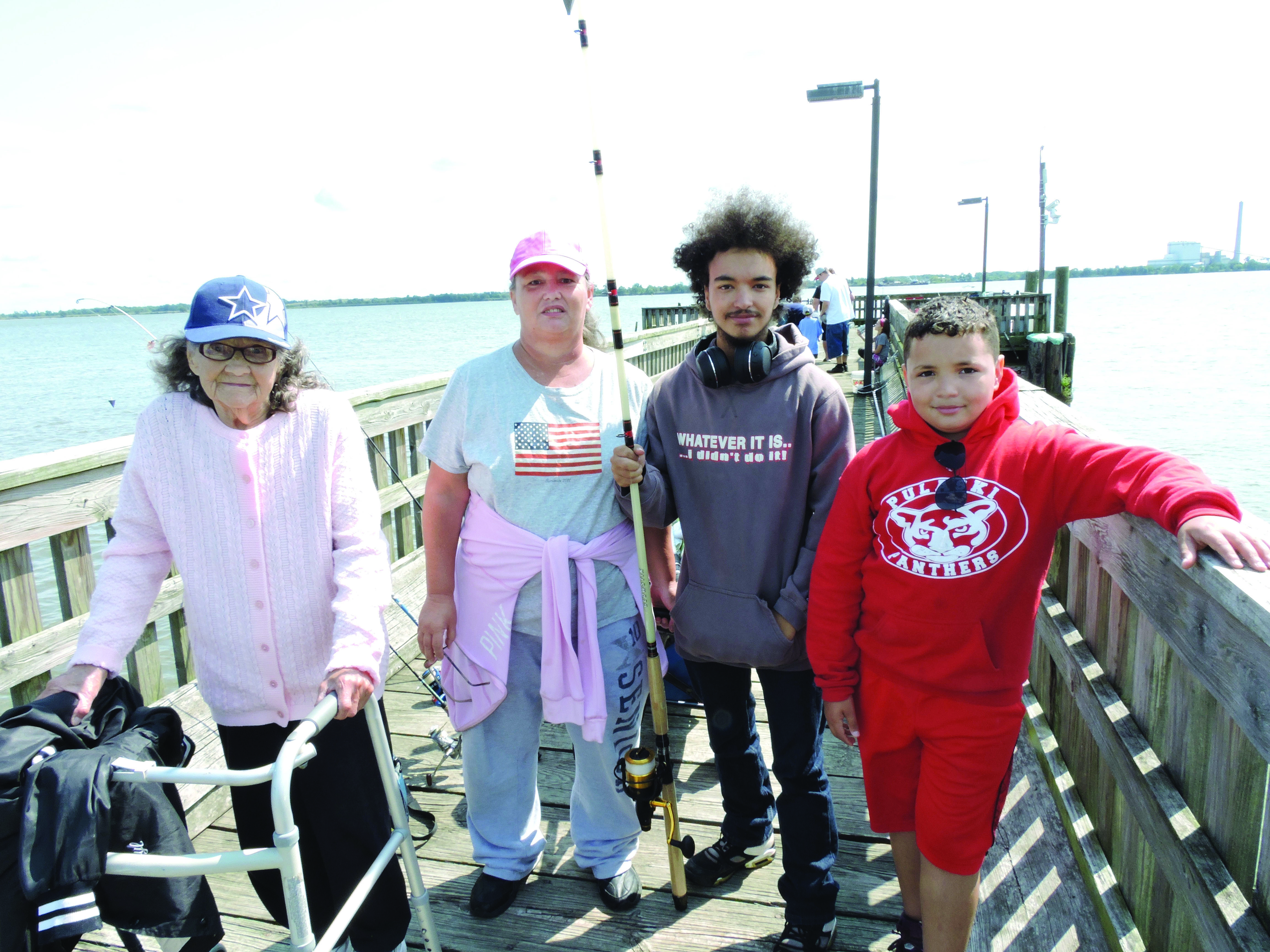 Great grandmother Grace Roth and, grandmother, Debbie Napier with Tyler and Virgilio Napier at the Marcus Hook Fishing Derby.
