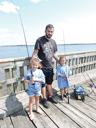 Jeremy Romano with his daughter, McKenzie and niece, Cameron, on the fishing pier in Marcus Hook.