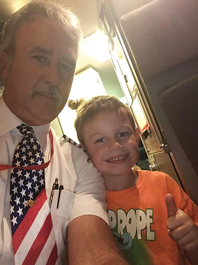 """Southwest Airlines """"Pilot John"""" noticed the young toddler attempting to self-administer insulin shots with the supervision of his mother, Christine Stiles, and invited the lad into the cockpit for a tour."""