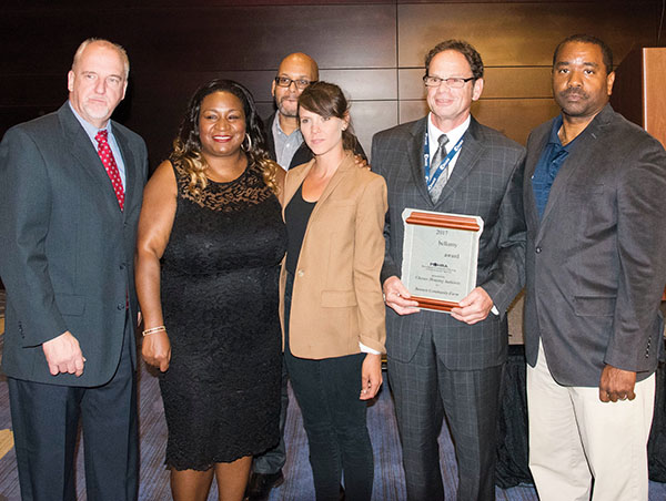 Accepting the award at the PAHRA conference in Lancaster were (from left) Fair & Square General Manager Mike Basher, CHA executive assistant Quineice Harris, Housing Operations Director Norman Wise, farm manger Natania Schaumburg, Executive Director Steven Fischer, and Andre Dixon, community relations manager of Fair & Square.