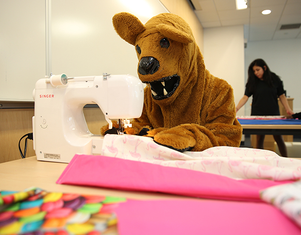 The Nittany Lion sewed colorful pillowcases for Case for Smiles, which will be given to patients at Penn State Children's Hospital.