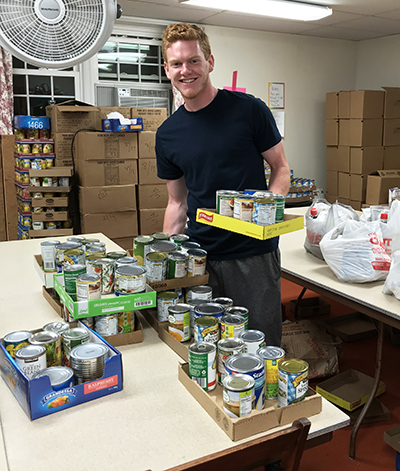 PSU Brandywine student Brian Reynolds, a member of the Marketing and Communications Club and baseball team, assisted with food distribution at Media Food Bank.