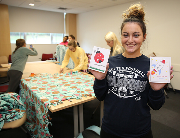 PSU sophomore Carly Dill displayed the cards she made for children who are hospitalized, while other students made blankets.
