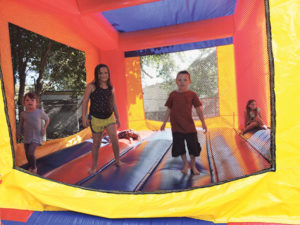 Trainer children enjoyed the inflatable trampoline.