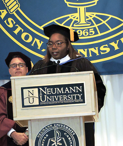 Neumann University student Rayanna Williams, '18, welcomes Dr. Chris Domes.