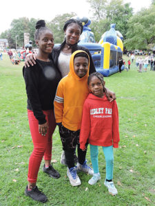 Sianni Newsome (center, rear) and the Boland family, Aniya, Christopher, 9, and Taylor, 6, enjoyed Glenolden Community Day.