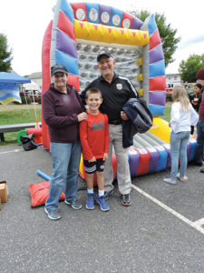 Parkside Police Chief John Egan, his wife, Kathy, and grandson, Shane enjoyed their event.