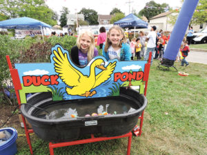 Lilly Parks and Makenzie Cleary worked the duck pond at Parkside's Community Day.