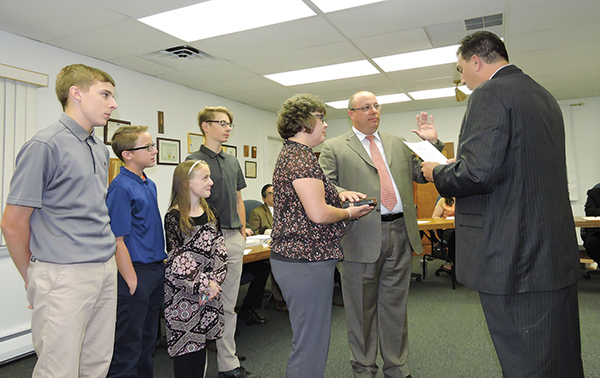 Newly-appointed Aldan Mayor Carmen Maniaci presided over swearing-in ceremonies for new Councilman Steve Maiden. With Maiden is his wife, Rebecca, and children Steven and Jacob and family friend Hunter Dorman.