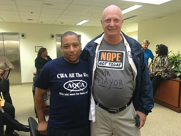 Bill Barber and Joe Stafford, CWA employees, make a political statement with their fashions.