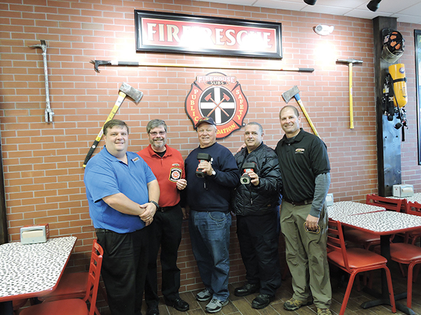 Brookhaven Fire Department President Jon Grant and Chief Rob Montella hold the new thermal imaging cameras purchased with a $16,355 grant from the Firehouse Subs Public Safety Foundation. They are joined by Rob Lowe, Firehouse Subs area representative, and Mark and Rick Lohkamp, owners of the Brookhaven store.