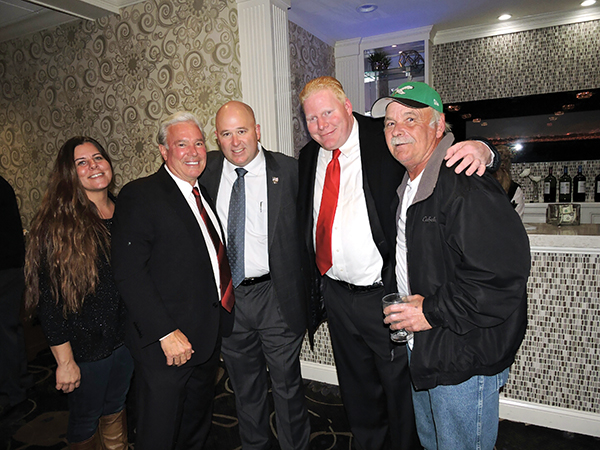 """Folcroft was """"in the house"""" as (from left) Lisa McGuigan, unsuccessful County Council candidate John Perfetti, Folcroft police Sgt. Christopher Eiserman, Folcroft Council President Jason McGuigan and Harry McGuigan, Folcroft's GOP leader, remained hopeful as the numbers came in."""