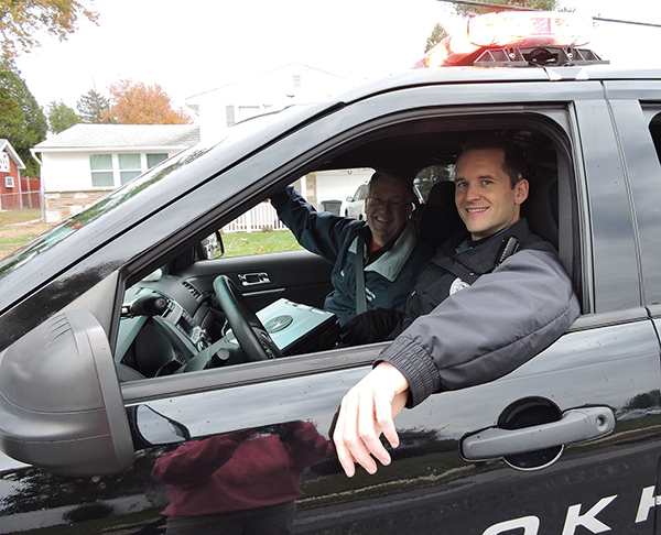 Brookhaven Mayor Mike Hess was driven by officer Tim Habich.