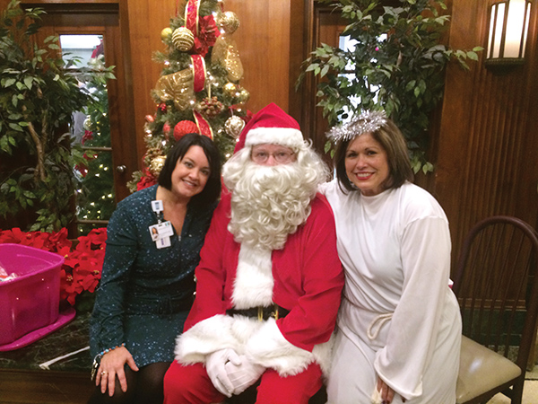 Lauren Carlin and Michele Zappile pose with Santa.
