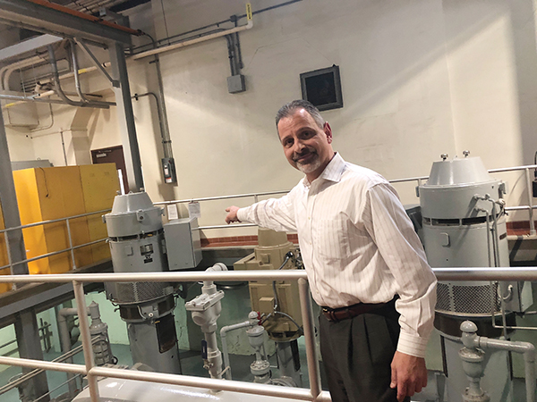 Aqua Pennsylvania President Marc Lucca points proudly to state of the art equipment at an Aqua water treatment plant in Springfield.