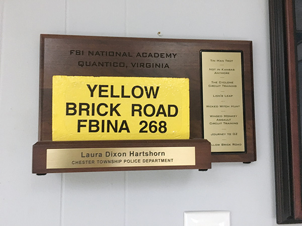 "The Yellow Brick Road is a metaphor for the variety of trainings FBI cadets endure at the Academy and is memorialized by a plaque that includes references to the iconic ""Wizard of Oz"" movie such as ""The  Tin Man Trot,"" the ""Lion's Leap,"" and the ""Winged Monkey Assault Circuit Training."""