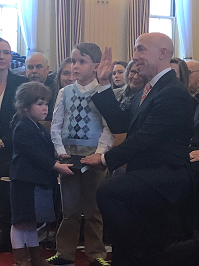 Newly-elected County Councilman Brian Zidek was sworn-in with his children, Milo and Audrey, holding the Bible.