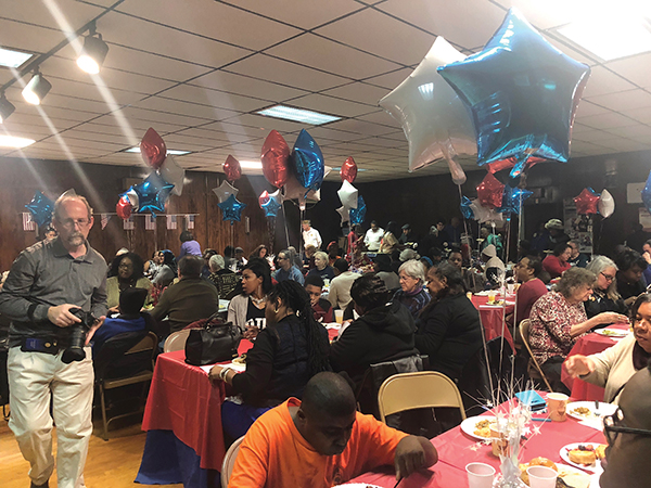 The standing-room-only crowd filled the VFW hall.