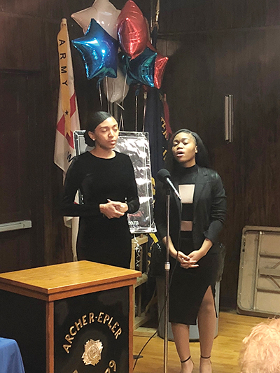 """Two Upper Darby students (from left), Rylee Curry and Sashaine Clarke, sang the visionary song, """"Imagine,"""" that was written and recorded by the late John Lennon."""