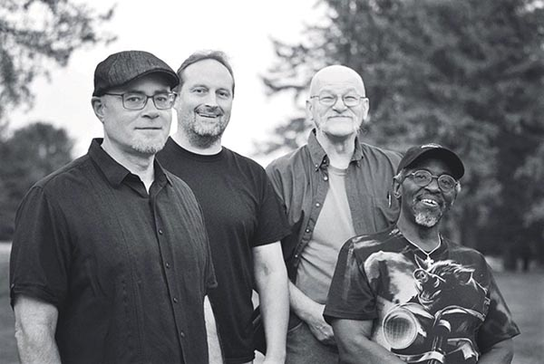 The Revolution Heroes (from left) Bucky Queppet. Bill Haaf, Larry Spencer and kidney transplant recipient Prince White.