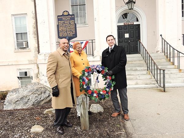 Rev. Dr. Bayard Taylor, Jr., Chester Councilwoman Elizabeth Williams and Crozer-Chester Medical Center President Michael Curran place a wreath at the site of the former Crozer Theological Seminary where Dr. Martin Luther King, Jr. earned his divinity degree.