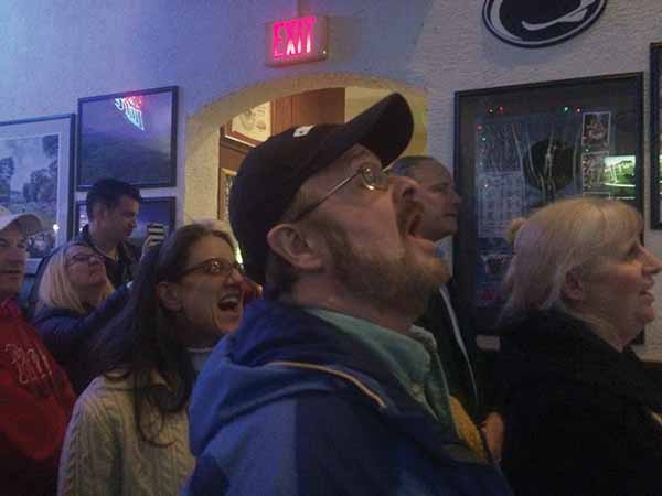 Folks join in the EAGLES fight song.