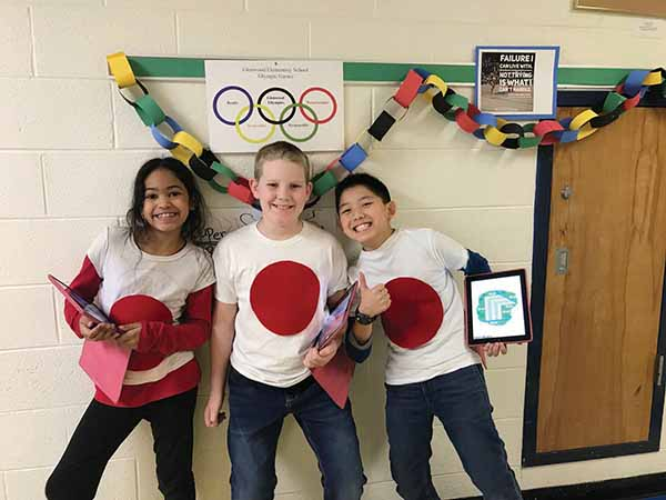 Fourth graders (from left) Jordyn Carroll, Charlie Majewski and Kyle Chen used their clothing to demonstrate Japanese flag.