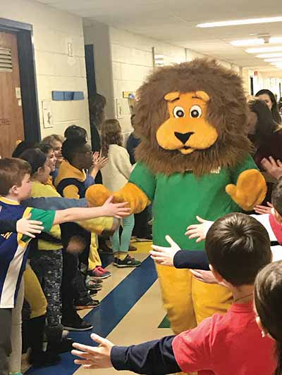 Woody, the school mascot, led the opening ceremony.