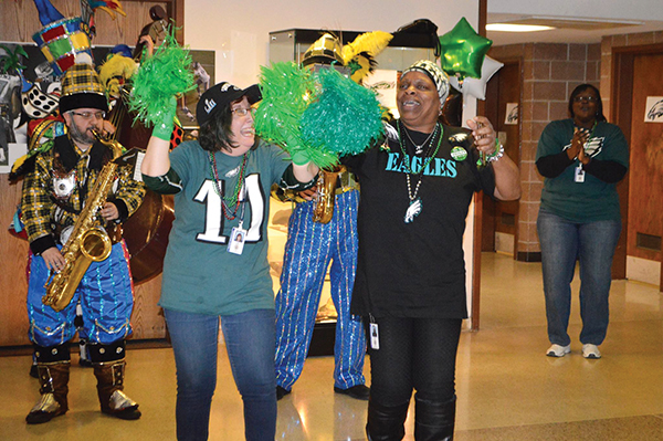 Robert Tiller, Omar Draughn, Nadiyah Shabazz, Baaquir Shabazz, Donna Davis, Cayla Davis-Clark  and Theresa Scott held a pep rally for the Philadelphia Eagles in the parking lot of the Widener Partnership Charter School in Chester.