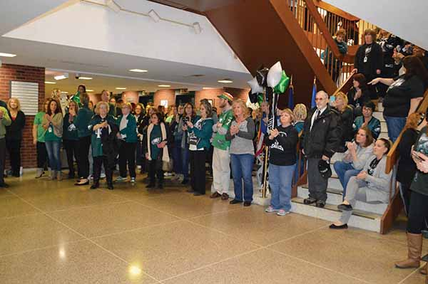 County employees, donned in their best green and white, gathered in the lobby of the Delaware County Government Center to cheer on the Philadelphia Eagles.