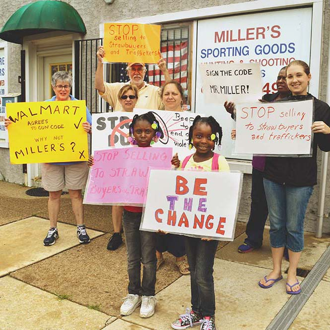 Activists take aim at local gun shop and owner fires back